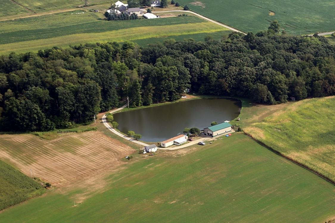 new pond along woods built by Orr construction apple creek