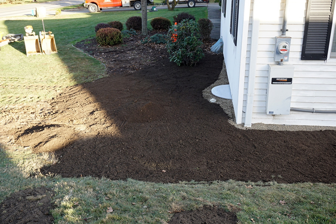 All excavated foundation areas are filled with gravel then covered with top soil