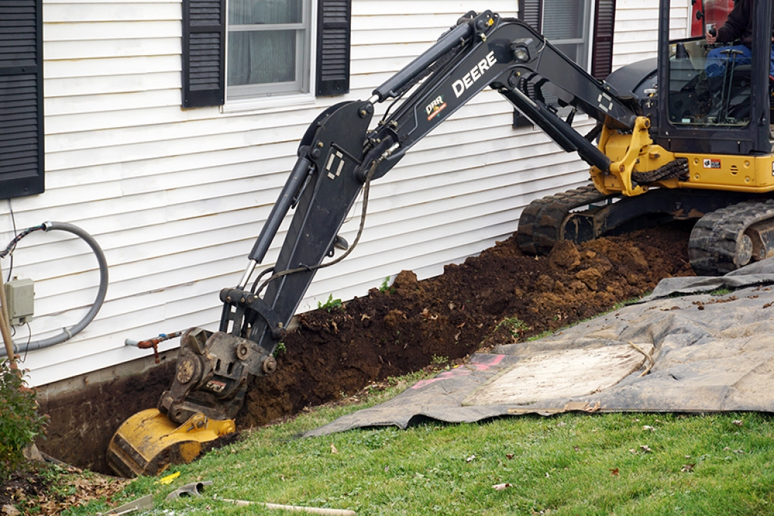 excavating to expose foundation