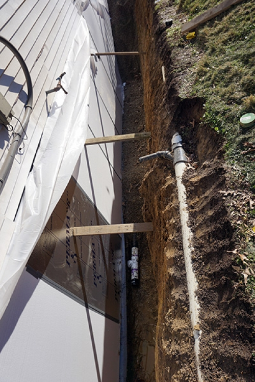footer drain tile set in place and covered with gravel