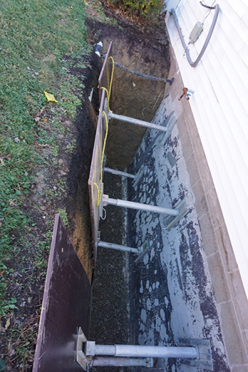 trench protectors in place and wall cleaned via high pressure wash