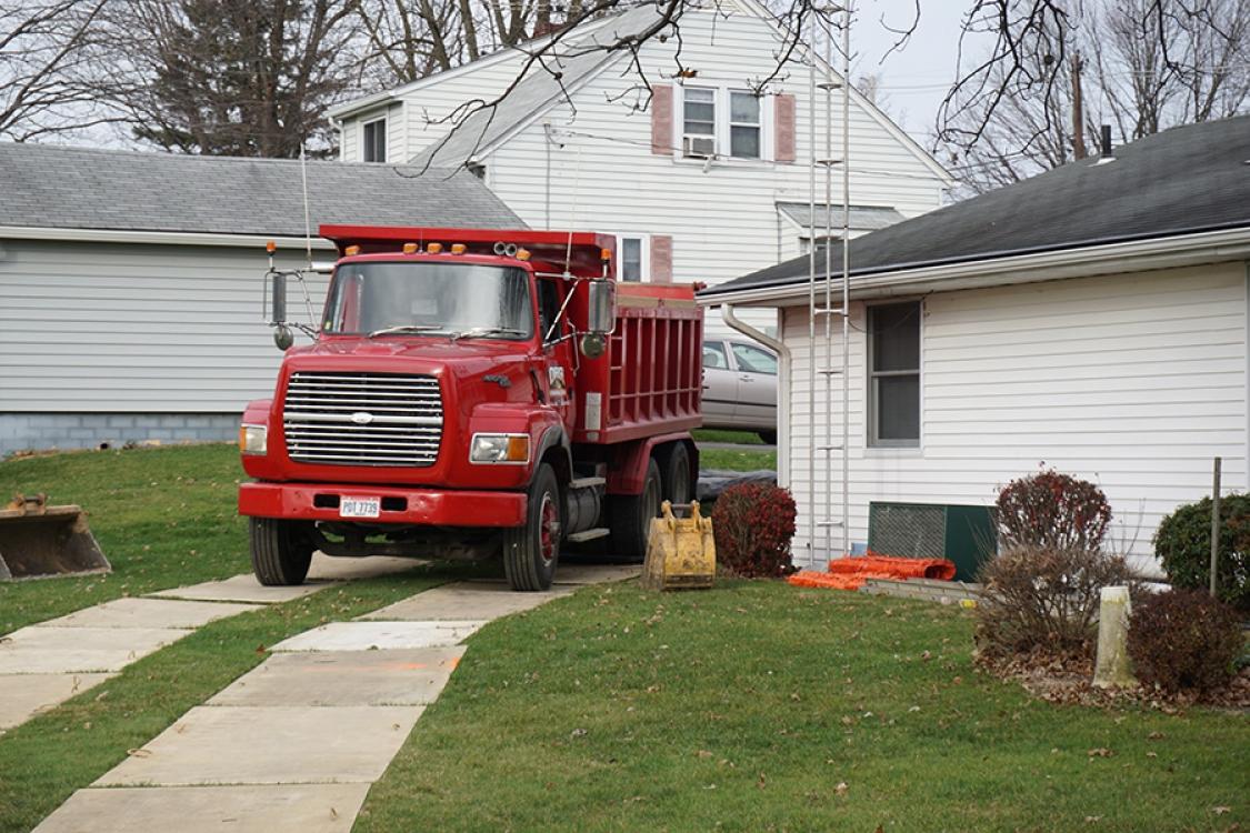 preparing to haul away excavating foundation fill
